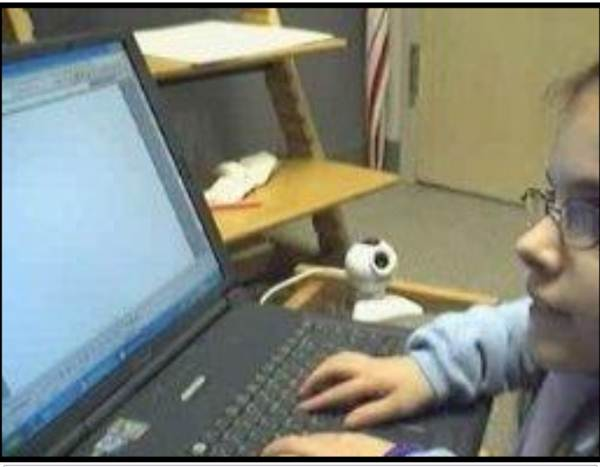 young student typing fast on a laptop